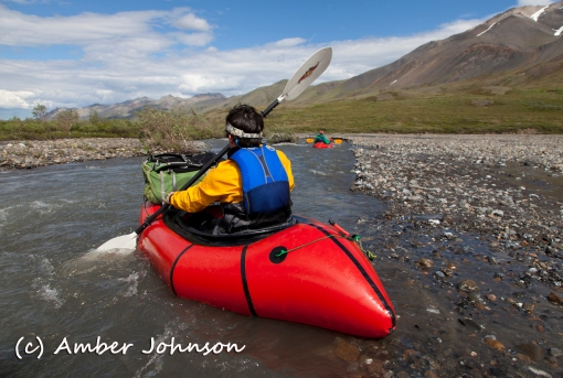 Kasey paddling